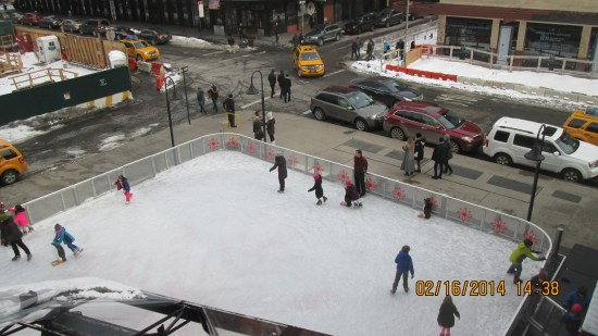 Neighborhood ice rink viewed from the high line.