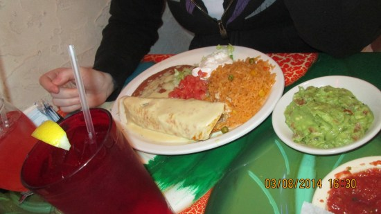 Lex got a chicken burrito with rice, beans and guacamole.