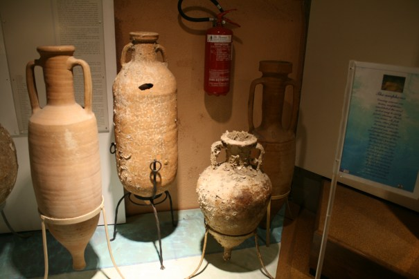 I believe the stands are of modern design.  All the frescoes and storage show the jugs leaned against a wall.