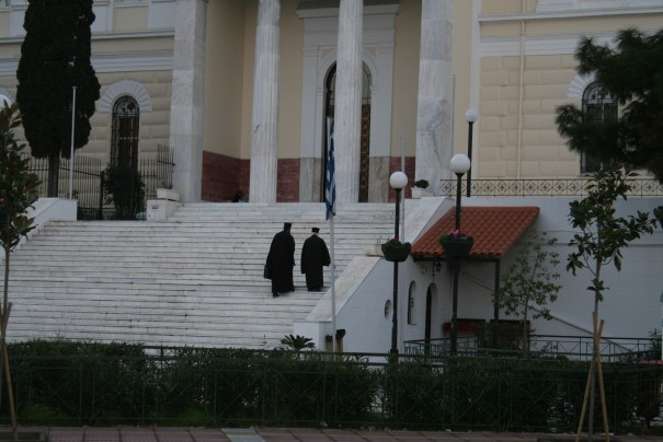 Greek Orthodox priests ascending the stairs.