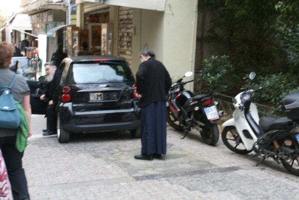 Priests getting out of the car.