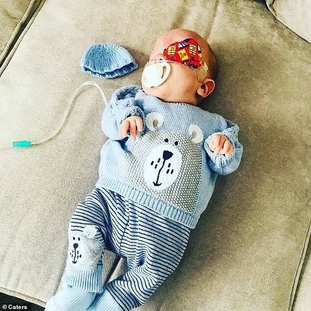 On five separate occasions, doctors told George's parents, Hanna Rose, 25, and her partner Daniel Bownes, 27, that baby George would die. He is now at home, pictured