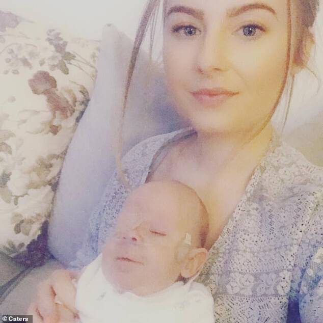 At 23 weeks pregnant, Hanna (pictured with her son) began to experience back pains, and spent four days in labour before giving birth