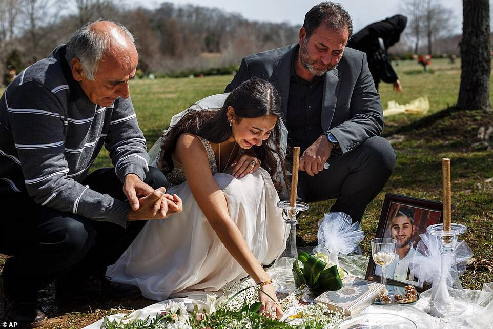 Baluch's loved ones, including her father Masoud (left) and her would-be father-in-law Mohssen Sharifi (right) joined her for a memorial atHarpeth Hills Memory Gardens in Nashville.'We were supposed to be together,' Baluch said as tears streamed down her face