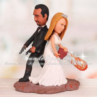 Zombie Wedding Cake Toppers Groom Holding Pistols Bride Wielding     Zombie Cake Topper Groom Holding Pistols Bride Wielding Chainsaw