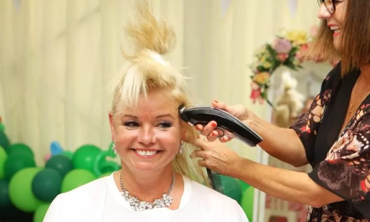 Claire Austin has her head shaven for charity Picture: Karyn Haddon