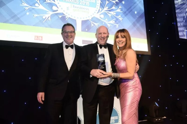 GLASGOW, SCOTLAND - DECEMBER 02: Anderson Maguire Funeral Directors win the Business Innovation Award, presented by Fraser Campbell, Partner, Campbell Dallas (left) at the 2015 Herald Scottish Family Business Awards at the Grand Central Hotel on December 02, 2015 in Glasgow, Scotland. (Photo by Jamie Simpson/Herald & Times) - JS