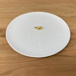 Porseleinen bord gouden vogel