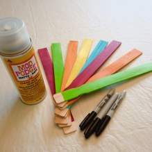 Colorful garden stakes using paint stir sticks, sharpie marker, paint and sealant. #diy #gardenstakes #makeitmonday #funhappinessandlife