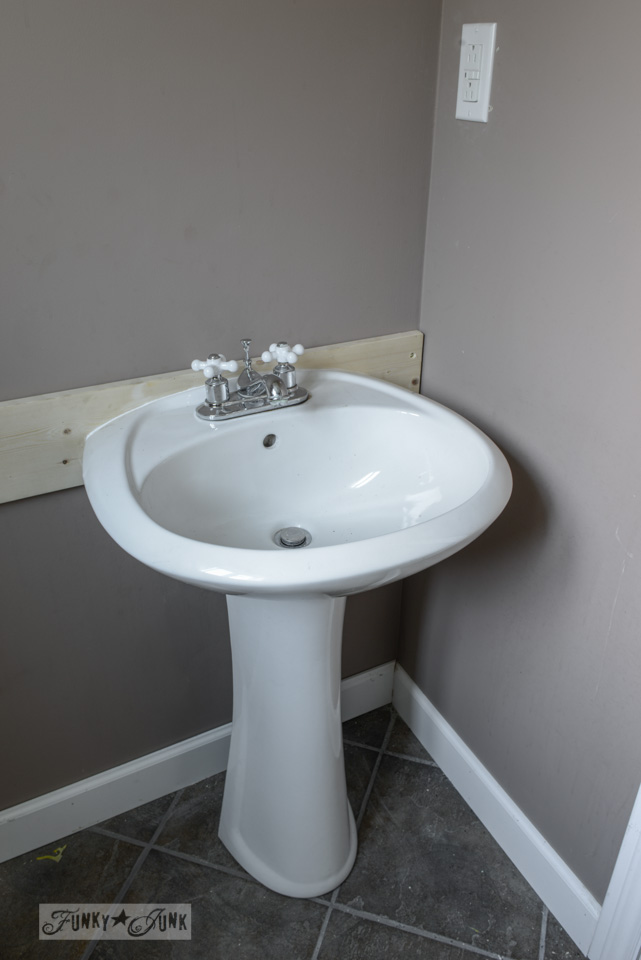 how to install a pedestal sink without