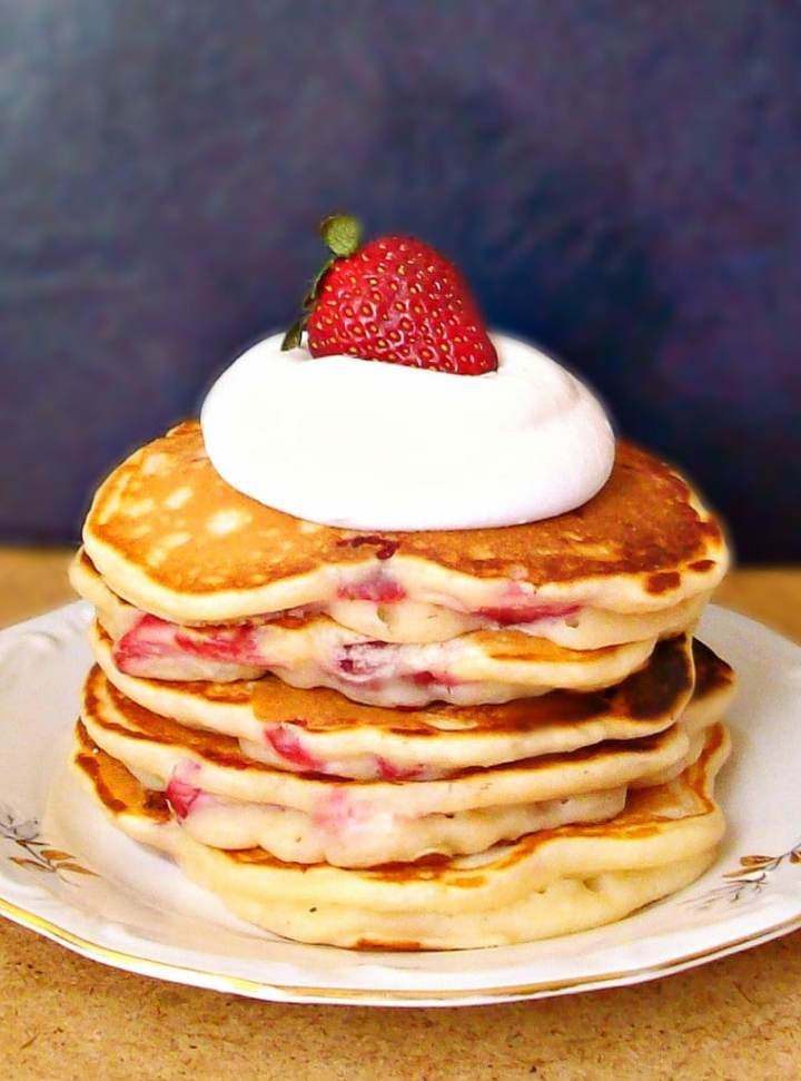 Strawberry pancakes with fresh strawberries. Love this whole list of strawberry recipe ideas - something for every meal!