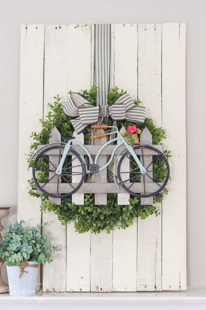 boxwood wreath with painted bicycle