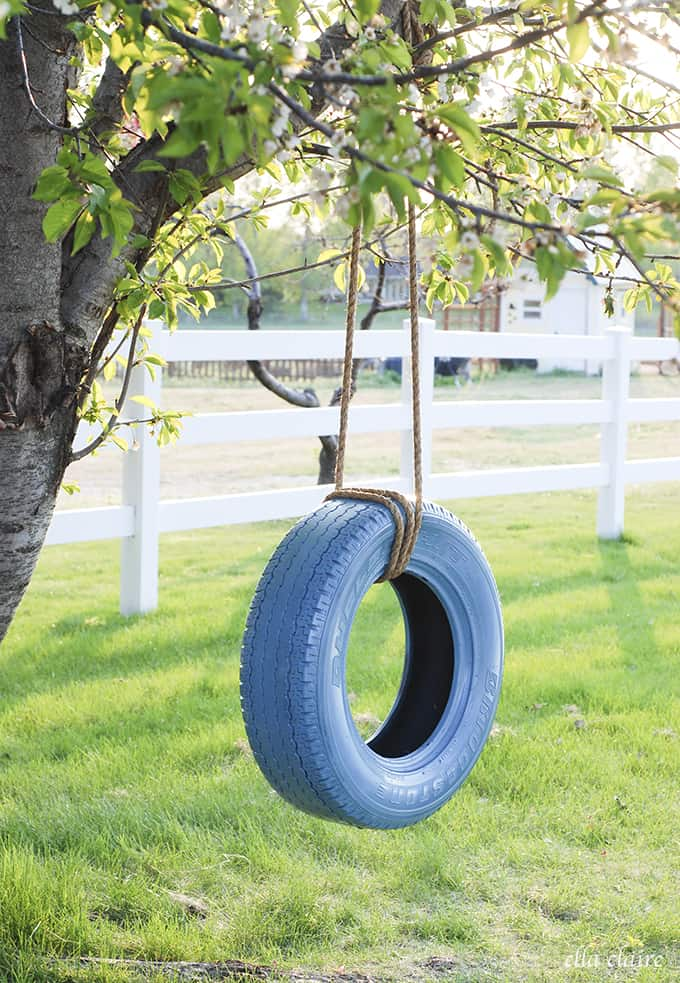 Learn how to hang a tire swing (via Claire Inspired) to add some charm to your kids backyard play space. A ton of awesome DIY backyard play area ideas.