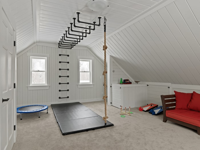 This is a great play space with a DIY climbing area for kids. Perfect for keeping the kids active when they're stuck indoors. via Fine Home Building