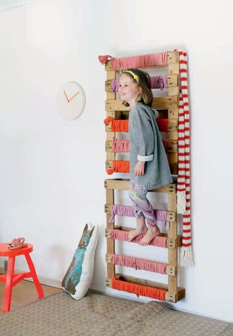 A wall-mounted pallet can be used to add a climbing element to your kids indoor play space. Check out all of the amazing DIY indoor climbing ideas.