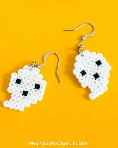 Cute DIY Halloween Perler Bead earrings. So fun, so cute, and so easy to make. Great Halloween craft for tweens or teens. #halloween #halloweencraft #halloweenDIY #halloweenearrings #halloweenperlerbeads #perlerbeads #perlerbeadearrings #funlovingfamilies