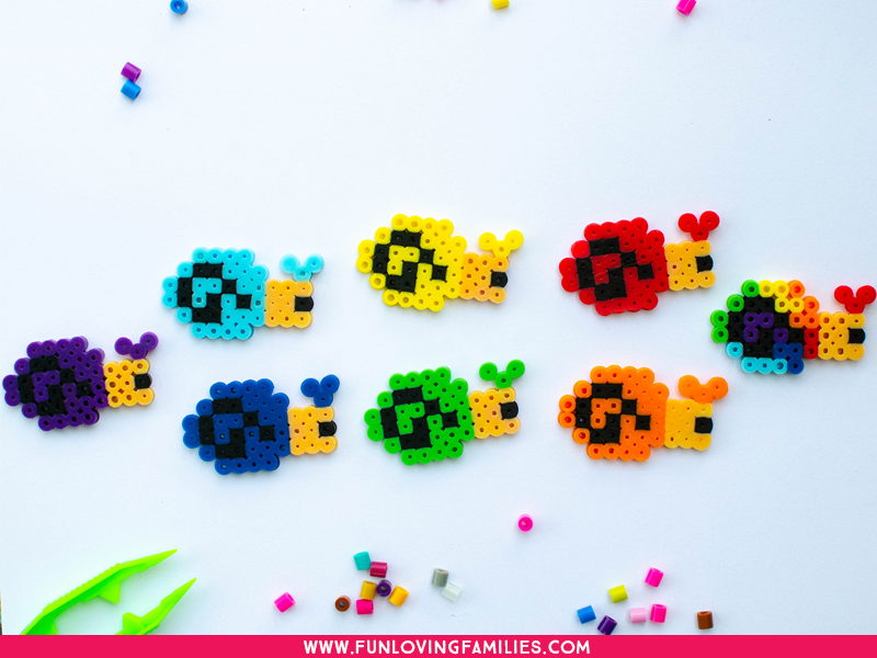 Perler bead snails in all colors of the rainbow
