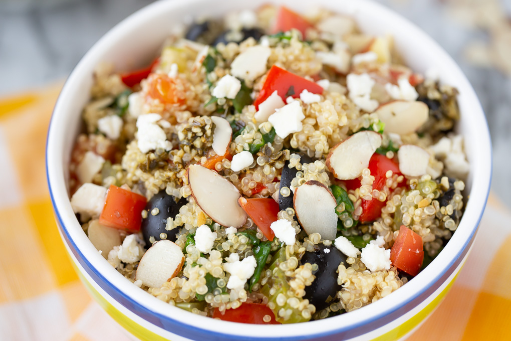 quinoa and veggies with almond slivers and olives