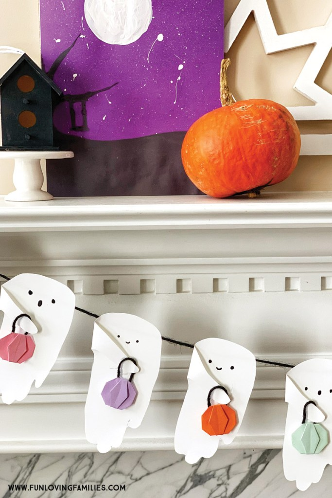 handprint ghost garland on mantel
