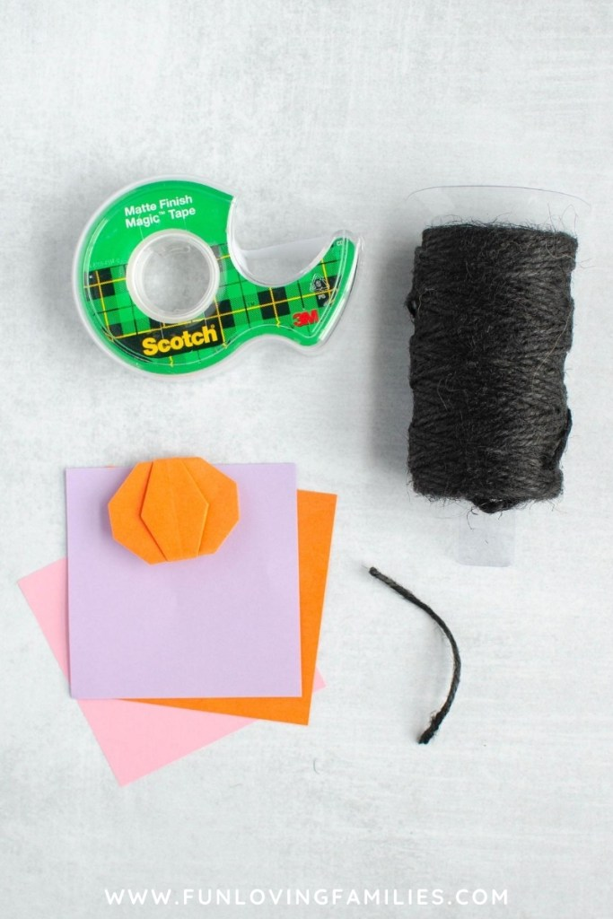 tape, black twine, and origami paper
