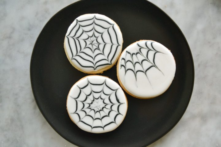 plate with iced spider web sugar cookies