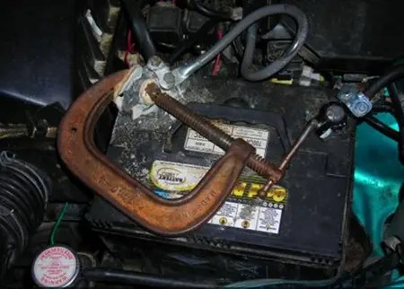 Giant C-Clamp used to hold cable on car battery