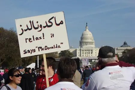 Middle Eastern mumbo jumbo protest sign (it says McDonalds)