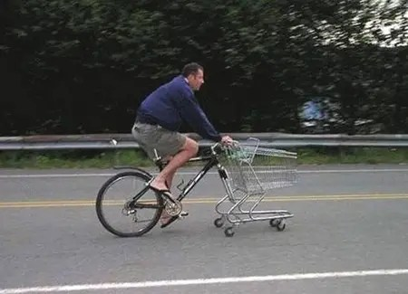 Shopping cart used to replace missing bicycle tire