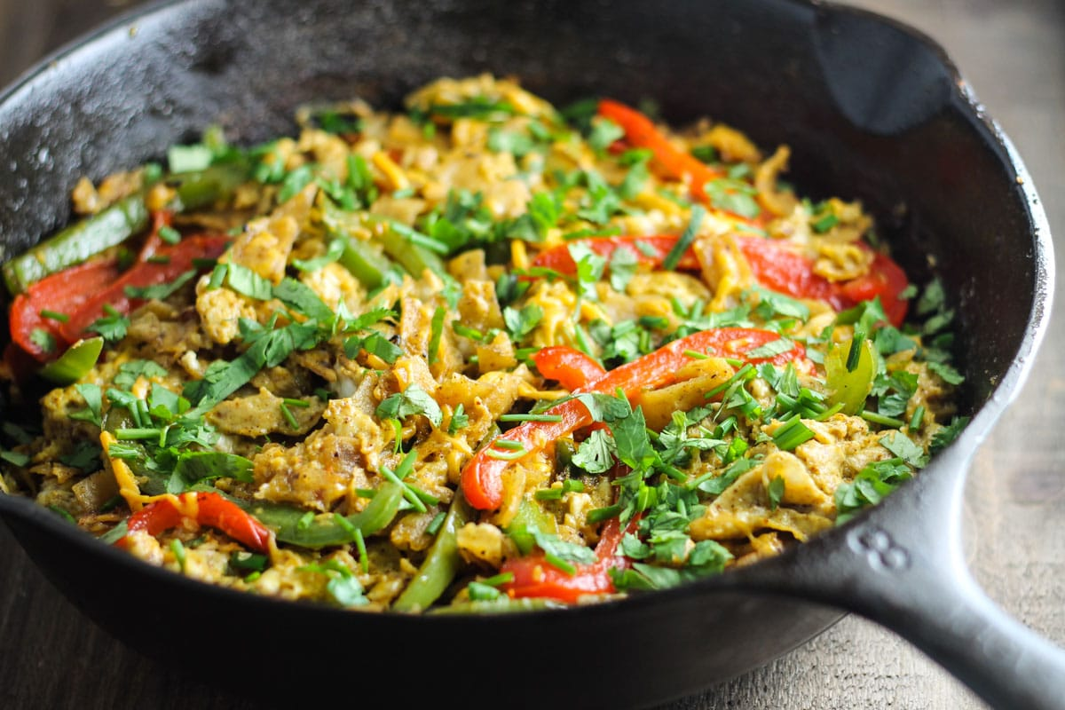 Try this Low Fodmap Fajitas Migas recipe! It's filled with fresh flavors, crispy tortilla chips and CHEESE! Yum!