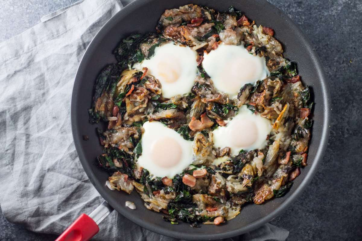 Filled with classic breakfast ingredients, this easy (and Whole30 compliant) Low Fodmap Bacon, Chard and Potato Hash is delicious anytime of the day!