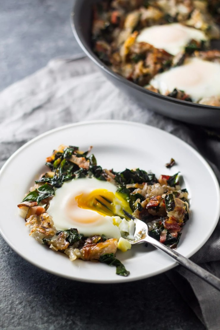 Filled with classic breakfast ingredients, this easy (and Whole30 compliant) Low Fodmap Bacon, Chard and Potato Hash is delicious for breakfast, lunch or dinner!