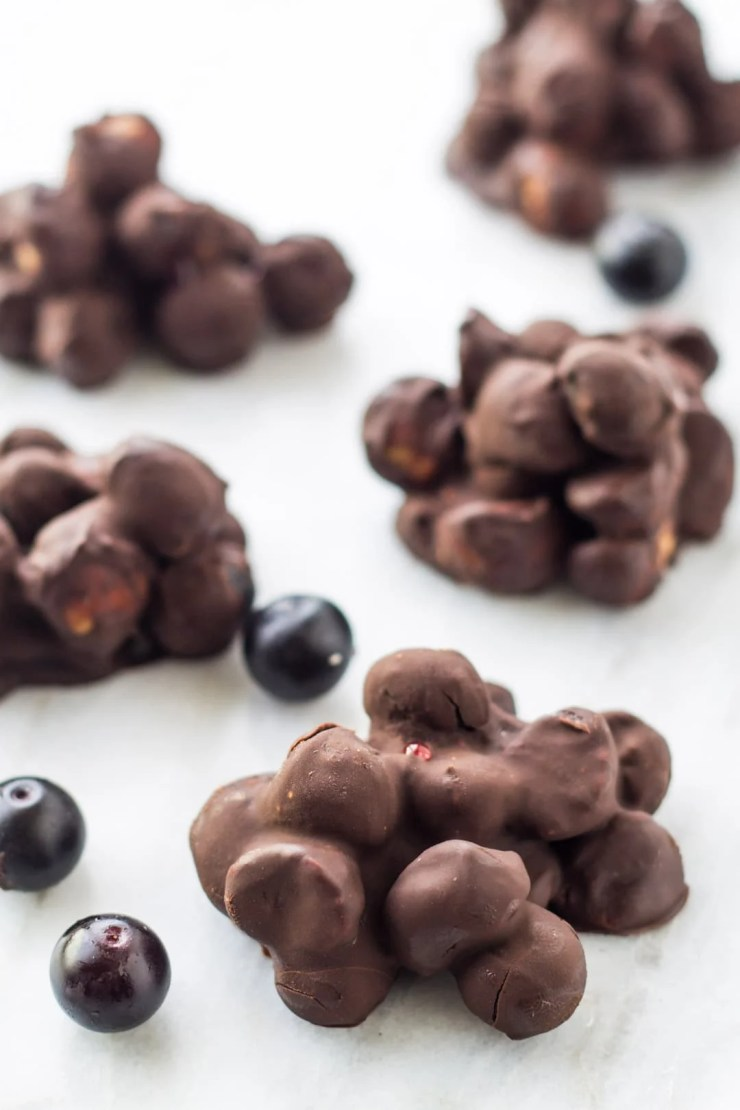 These kid-friendly Low FODMAP Dark Chocolate Blueberry Mac Nut Clusters are easy to make and can be enjoyed refrigerated or frozen!