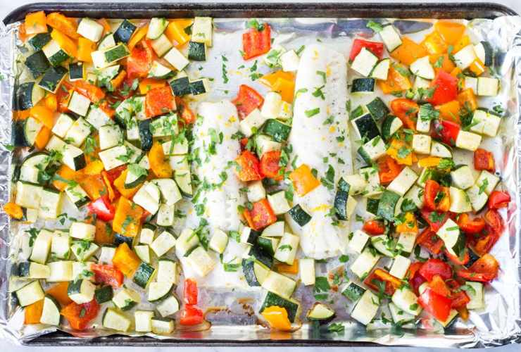 This Whole30-compliant Low Fodmap Lemon Cod Sheet Pan Meal recipe is filled with roasted Mediterranean veggies and fresh lemon.