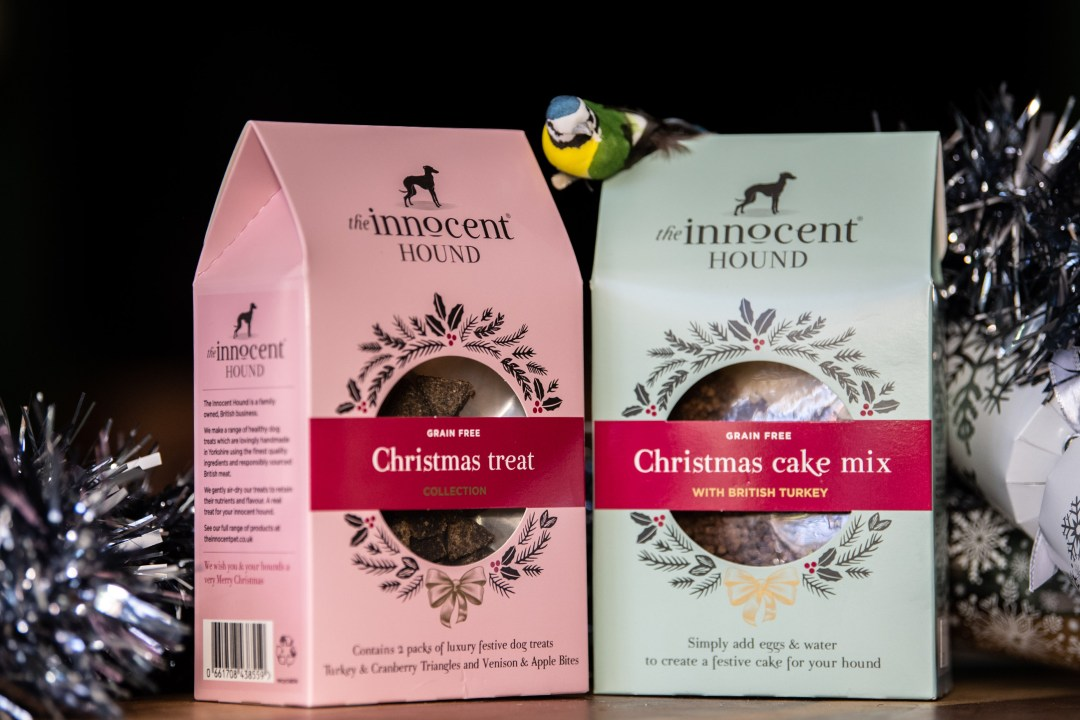 boxes of natural dog treats by the innocent hound