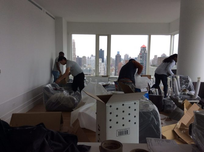 Furnishr team assembling furniture in living room