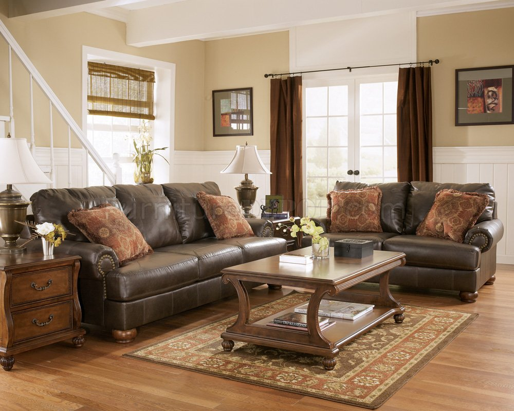 The living room is one of the most important areas in your house for a great hosting experience. Truffle Color Rustic Living Room with Nailhead Deatils By ...