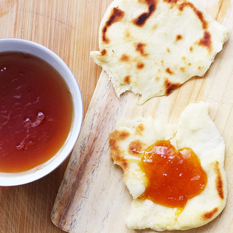 Easy Indian Naan Bread Recipe, homemade, soft and so delicious! This will be you new favorite bread to make at home, try this at your next family dinner. | Fusion Craftiness.com
