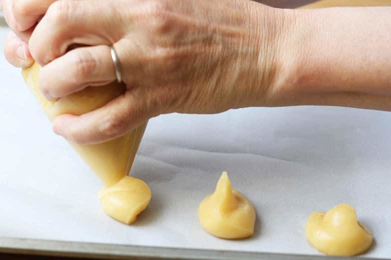 Step-by-step instructions and photos for Pate-a-Choux pastry and profiteroles. This French pastry is NOT hard to do! A great beginner pastry for home cooks! Bon Appetit!! | FusionCraftiness.com