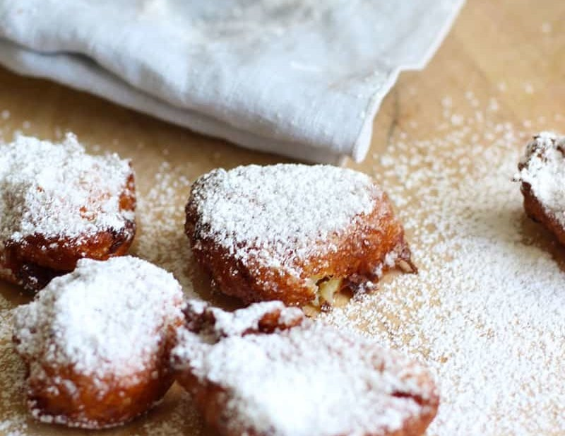 Easy Beignets For The Home Cook. Starting with a pate a choux and ending in powdered sugar, this New Orleans donut is actually a French classic made easy for the home cook. Bon Appetit! | FusionCraftiness.com