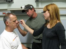 Dennis P. gets a touch-up from Jesse and Stefania