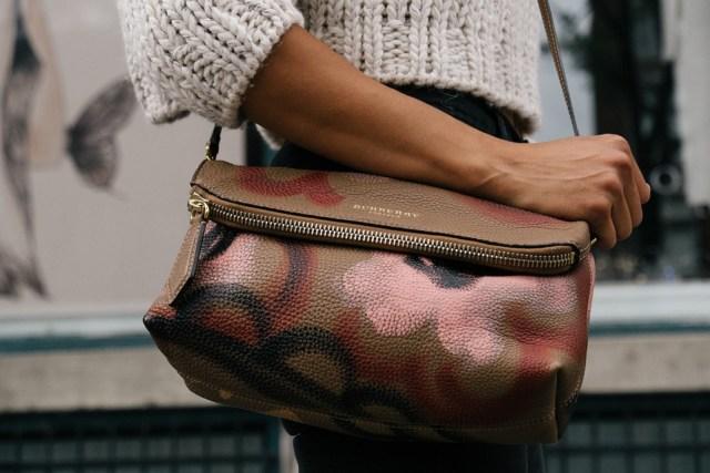 money domestic abuse / woman holding purse
