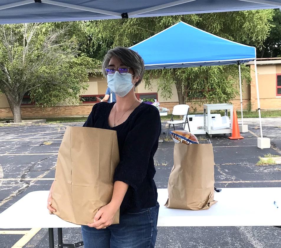 Lenexa Drive-thru food pantry pre-packaged food bags COVID