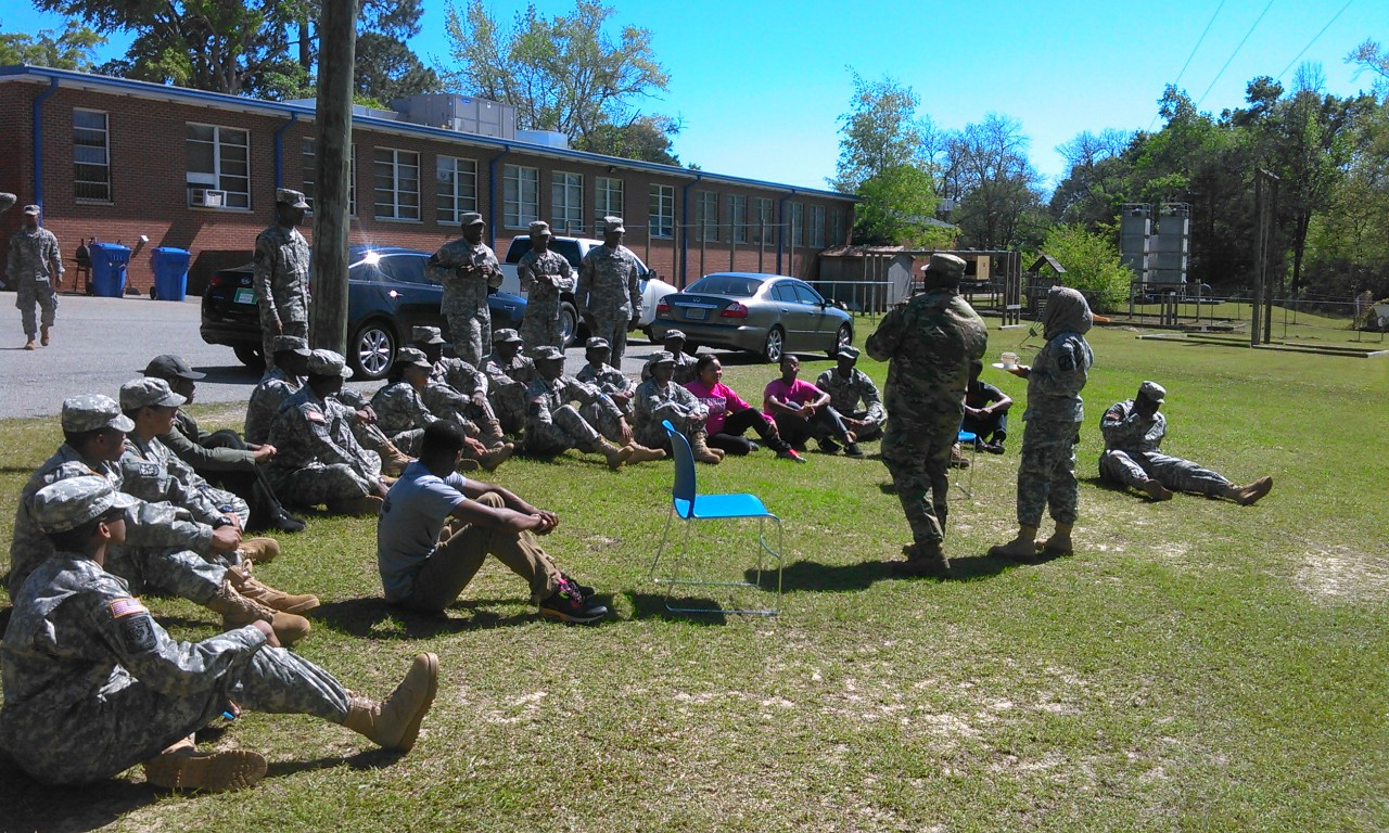ROTC students listen to their leaders.