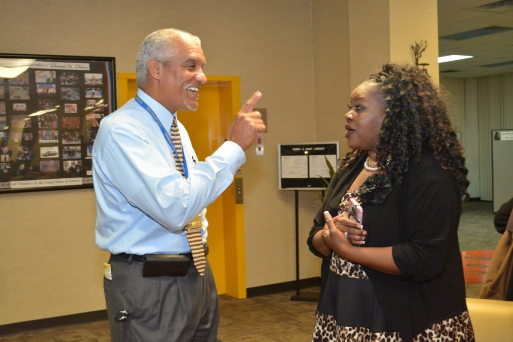 Wallace Keese talks to Randall Barnes' mom at the student's book signing.