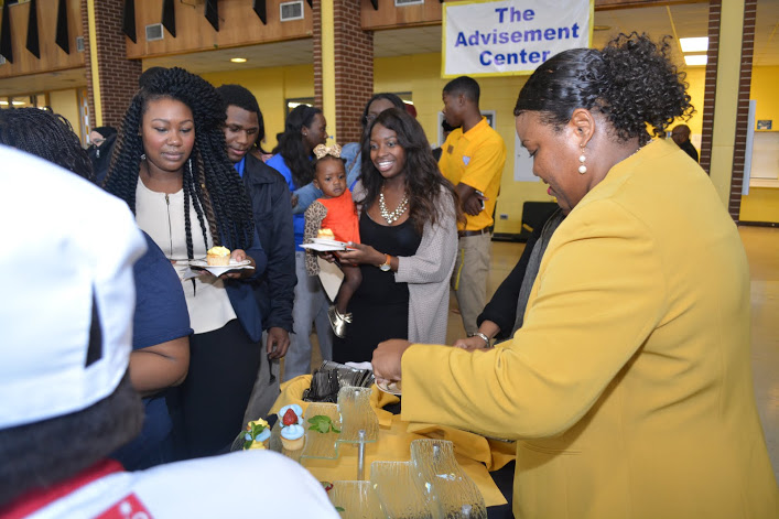 Ms. Pamela Berry-Johnson, director of marketing, serves cupcakes during the120th Anniversary Celebration