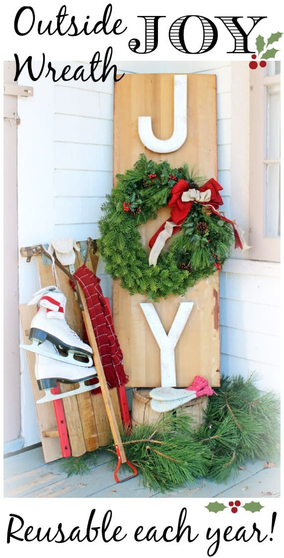 Outside Joy Wreath- The Great Canadian Wreath Hop |Joy Sign by popular DIY Canada blog: image of a Joy Wreath sign leaning up against a house next to a pair of white ice skates.