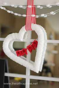 How to make a heart shaped wreath for only $2, a craft featured by top US craft blog, FYNES DESIGNS |Heart Shaped Wreath by popular Canada DIY blog, Fynes Designs: image of a  white heart shaped wreath.