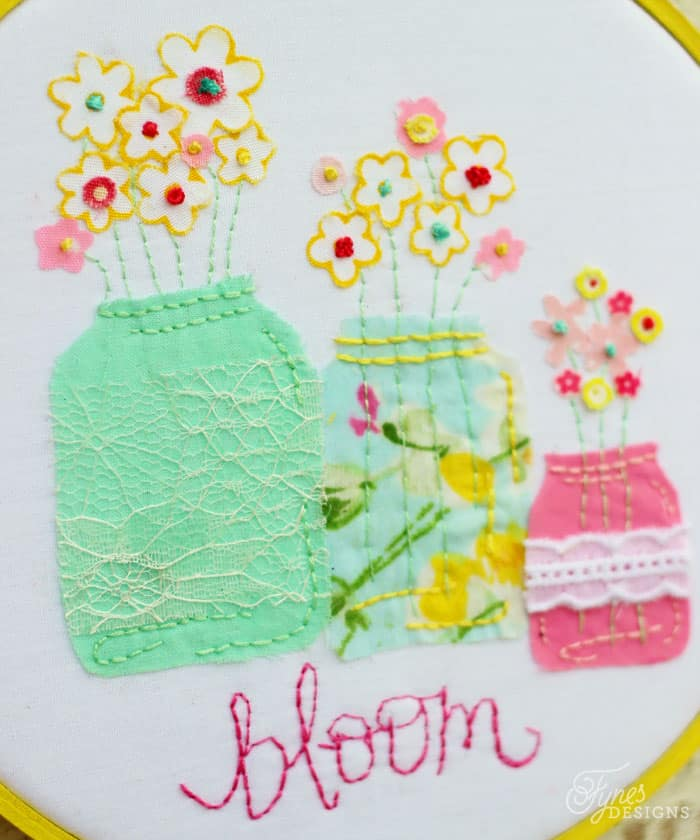 Fabric flowers with an embroidered french knot centre