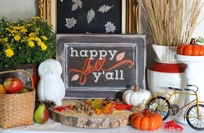 Happy Fall Y'all Painted sign on a beautiful fall vignette