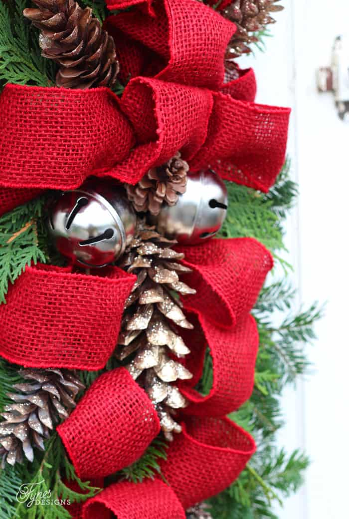 Learn to make a Christmas swag with this easy to follow tutorial. Easy outdoor Christmas decorations May Arts red burlap